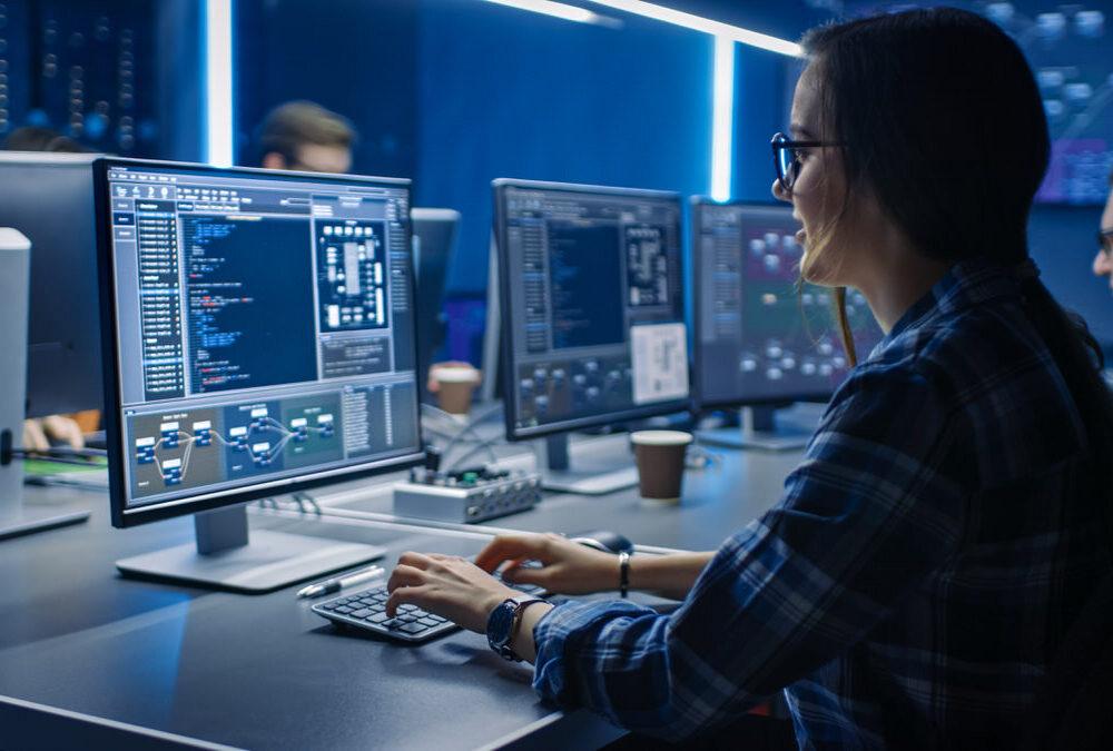 Smart,Female,It,Programer,Working,On,Desktop,Computer,In,Data