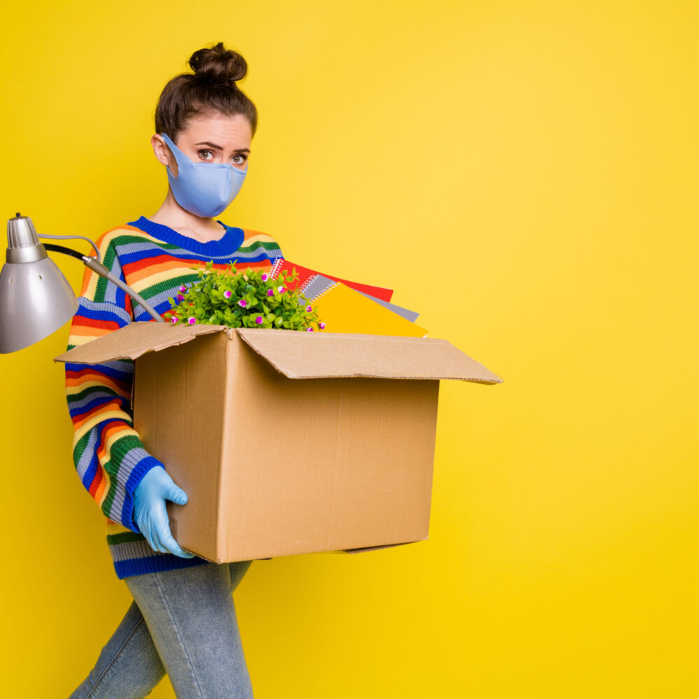 Profile photo of girl go with box got fired wear blue mask gloves from corona rainbow sweater pants isolated on bright yellow color background.